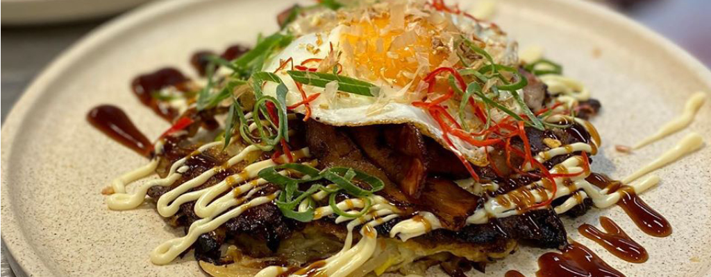 Okonomiyaki Pancakes are a traditional Japanese breakfast available at Hooch & Co Toowong
