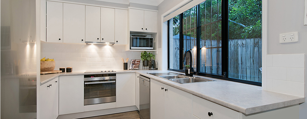 Modern kitchen in a freehold house in Toowong sold for $885,000