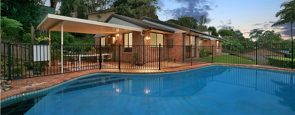 Brick house with a pool overlooking Indooroopilly