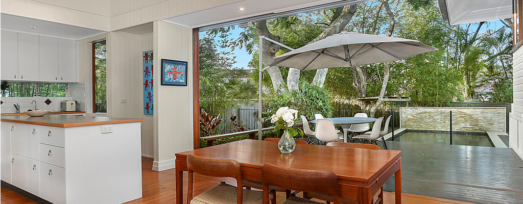 Open plan dining and kitchen looking out to pool area in St Lucia