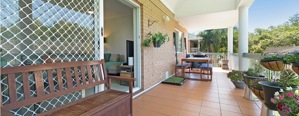 An investment property with balcony with plants in Taringa