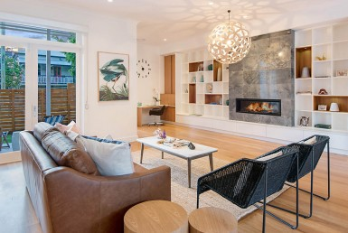 Lounge room with fireplace and timber floors in Paddington, Brisbane